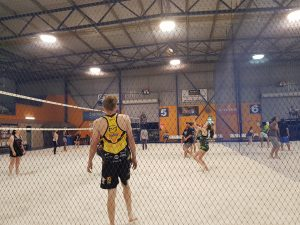 Team members playing a volleyball game-Bunbury Indoor Beach Volleyball-08 9726 0200