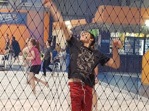 player serving during volleyball game-Bunbury Indoor Beach Volleyball-08 9726 0200